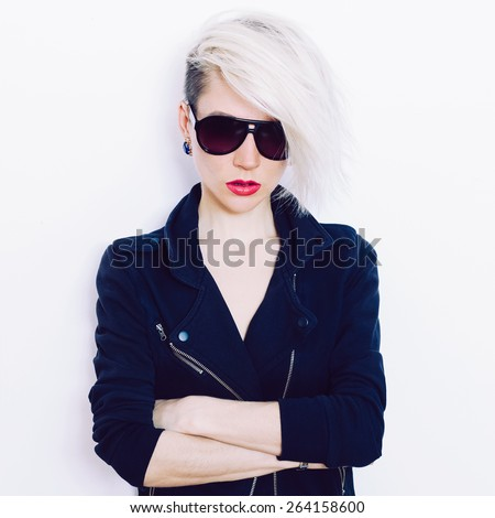 Blonde girl with trendy Hairstyle and fashion Sunglasses - stock photo