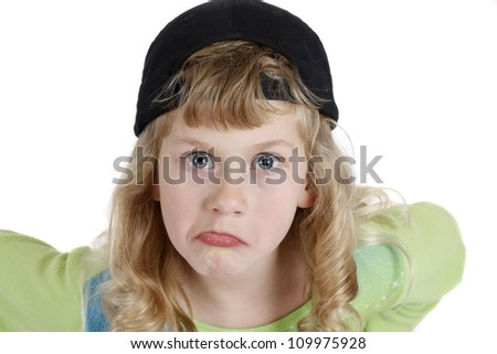 Blonde hair blue eye girl making faces at the camera - stock photo