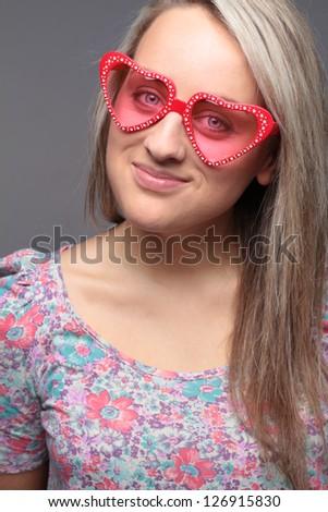 blonde happy teenage girl with heart sunglasses - stock photo