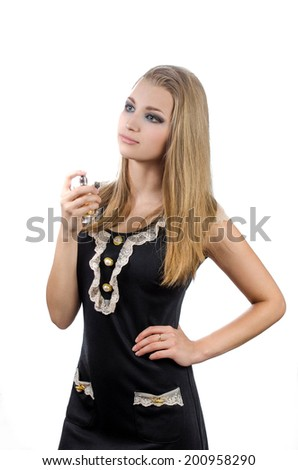 Blonde in a black dress holding a perfume. Girl on a white background with perfume. - stock photo