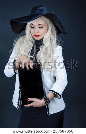 blonde in a black hat with box