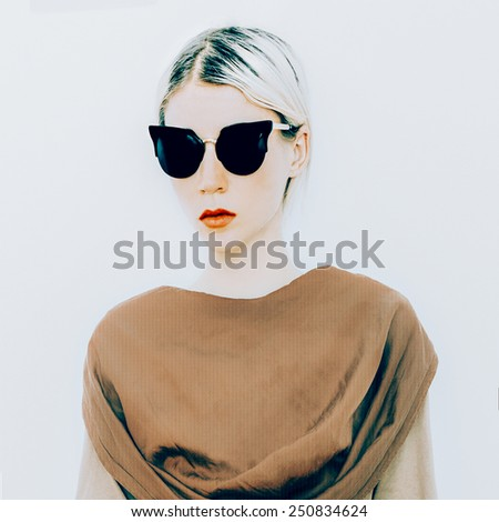 Blonde in luxury Sunglasses. Sunglasses cat eyes trend of the season - stock photo
