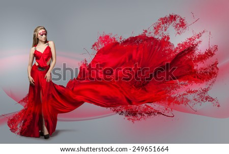 blonde in windy red  dress. Beautiful girl with creative make-up