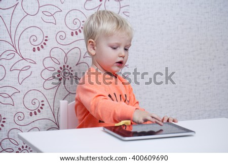 Blonde little boy play in pad at home