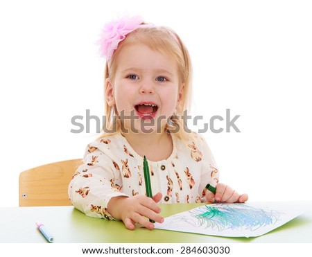 Blonde little girl draw with felt-tip pen sitting at the table- isolated on white background - stock photo