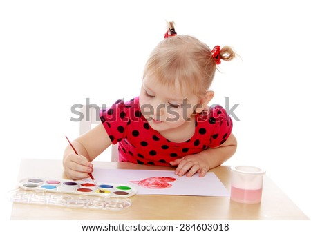 Blonde little girl draws paints table now- isolated on white background - stock photo