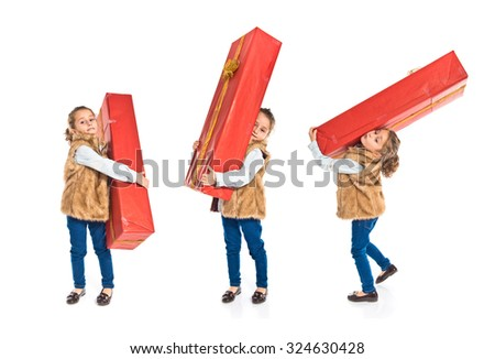 Blonde little girl holding a big red gift - stock photo