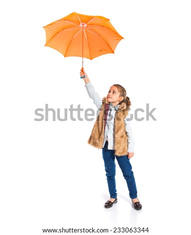 Blonde little girl holding an umbrella - stock photo