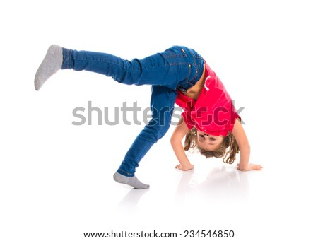Blonde little girl jumping - stock photo