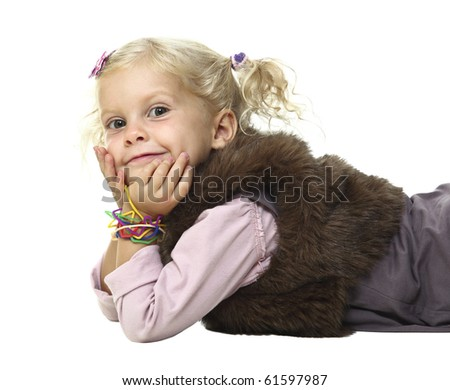 blonde little girl layed on white floor