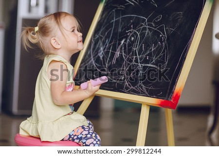 blonde little girl learning to draw