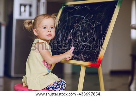 blonde little girl learning to draw - stock photo