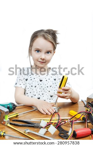 Blonde little girl repair a computer component - stock photo