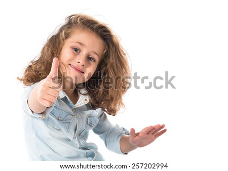 Blonde little girl with thumb up - stock photo