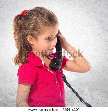 Blonde little girl with vintage phone - stock photo
