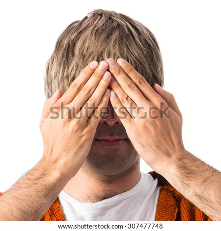Blonde man covering his eyes