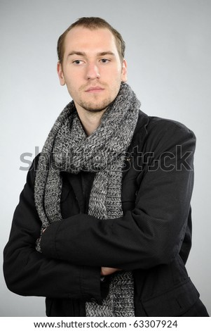 blonde man posing with scarf