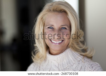 Blonde Mature woman smiling - stock photo