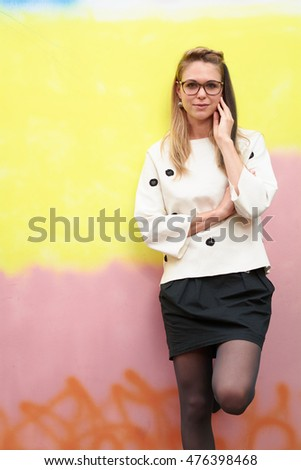 Blonde millennial against a colorful urban fashion background