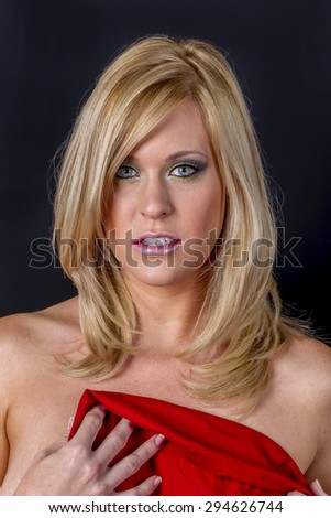 Blonde model in a studio environment - stock photo