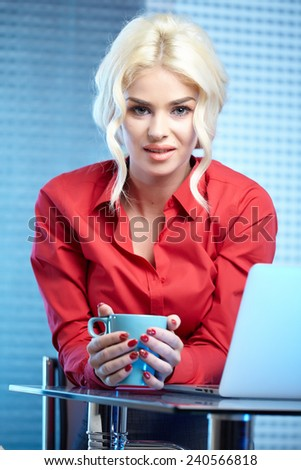 Blonde pretty business woman working at her office. She is very busy and hot.  - stock photo
