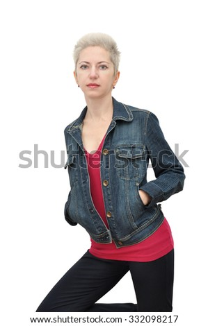 Blonde short hair woman with pixie cut standing in casual outfit, hands in pockets
