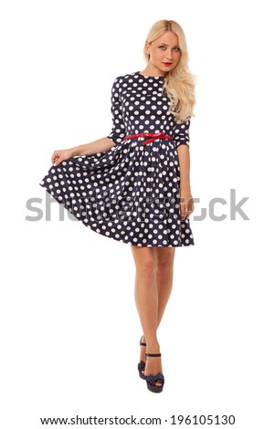 blonde slim girl in dot dress and shoes over white background