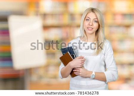 Blonde student with stack of books