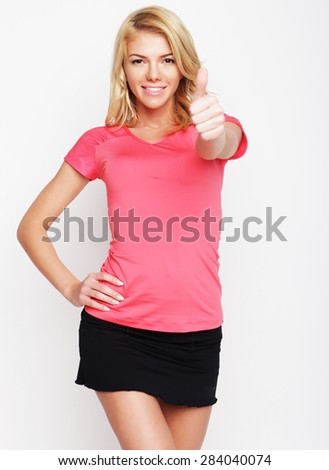 blonde very happy fitness woman showing thumb up on white background - stock photo