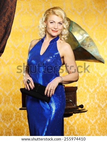 blonde Vintage fashion Senior woman with gramophone. elegant pretty woman in vintage evening dress. Retro Woman Portrait. Romantic Beauty. - stock photo
