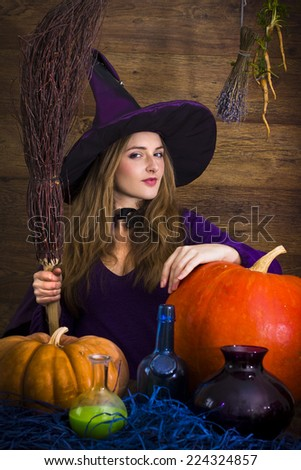 blonde witch with a broom and pumpkins for Halloween
