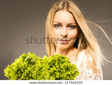 blonde with green salad - stock photo