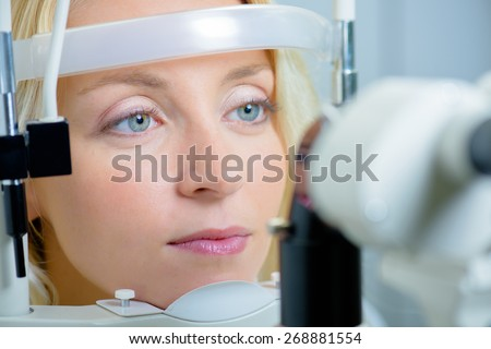 Blonde woman about to have her sight tested - stock photo