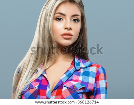 Blonde woman beauty portrait close-up isolated on gray background - stock photo