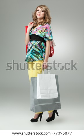 blonde woman carrying shopping bags high heels