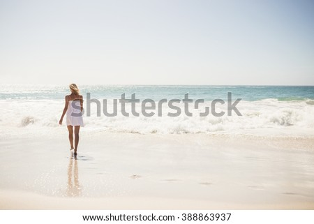 Blonde woman close to water at the beach