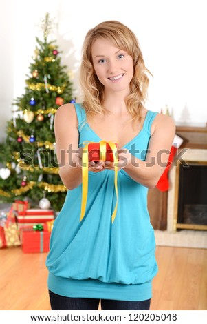 Blonde woman giving christmas present