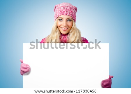 blonde woman holding blank white paper over blue - stock photo