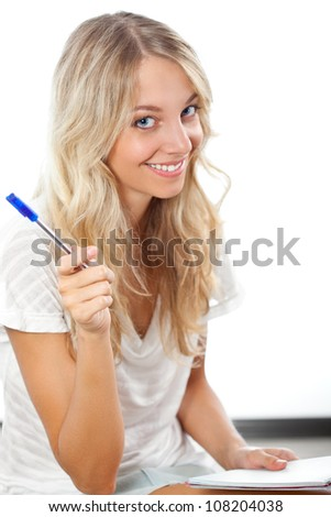 blonde woman holding pen and notepad - stock photo