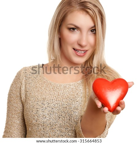 blonde woman holding red heart