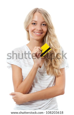 blonde woman holding yellow credit card - stock photo