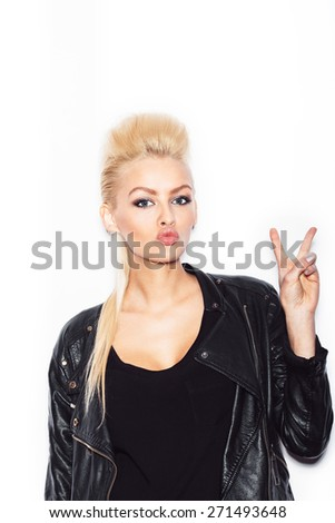 Blonde woman in a black dress holding her hair  - stock photo