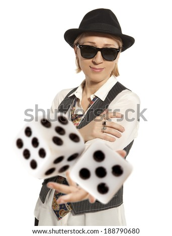 Blonde Woman in a hat playing dice isolated - stock photo