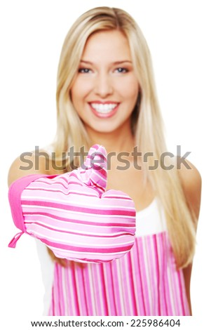 Blonde woman in a kitchen apron - stock photo