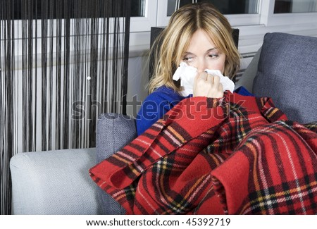 Blonde woman in bed looking - stock photo