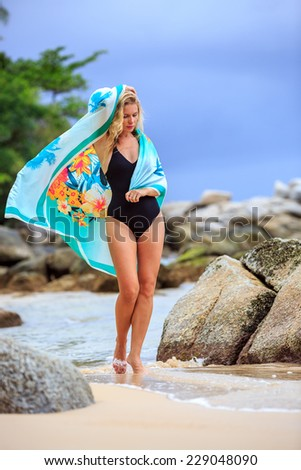 Blonde Woman in Black Swimsuit Standing At The Beach