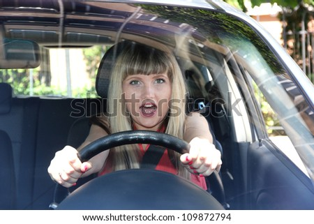 Blonde woman in car - stock photo