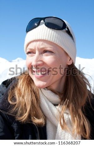 Blonde woman in mountain sunshine