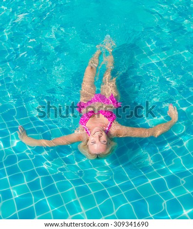 Blonde Woman In Pink Bikini  - stock photo