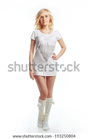 blonde woman in white clothes and socks on white background